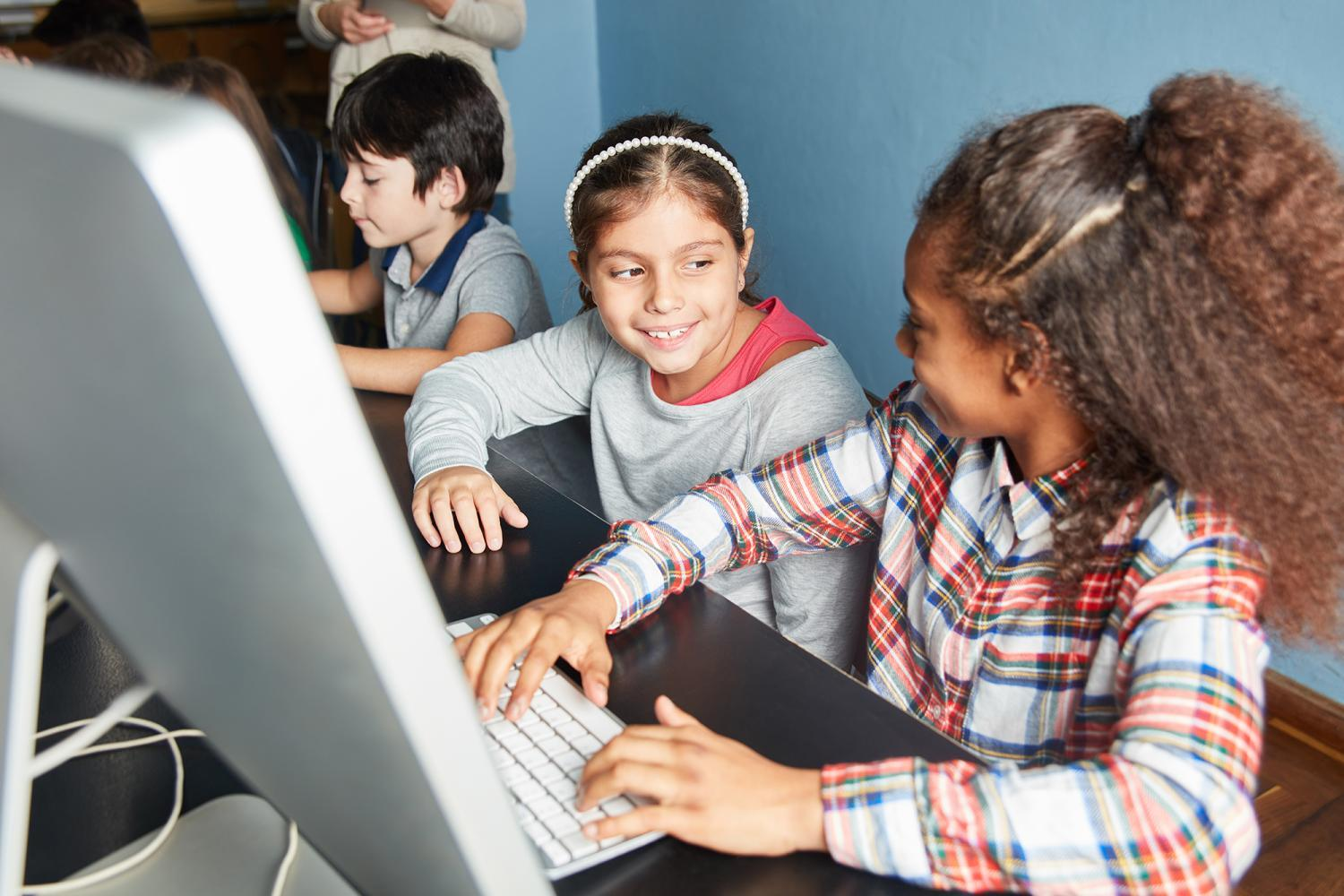 kids working on a computer together