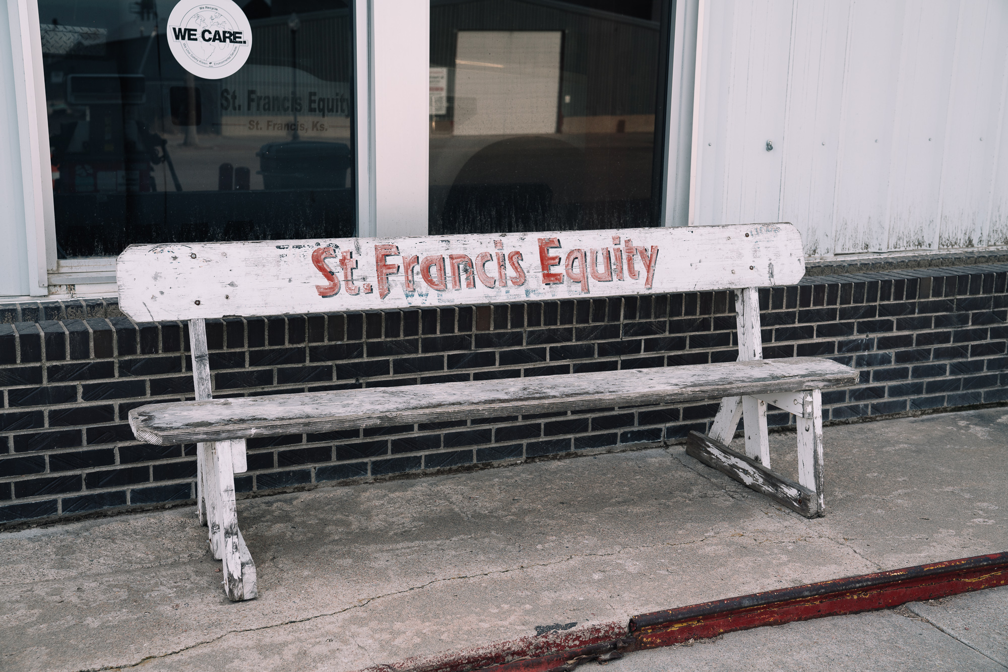 white bench with St. Francis written on it